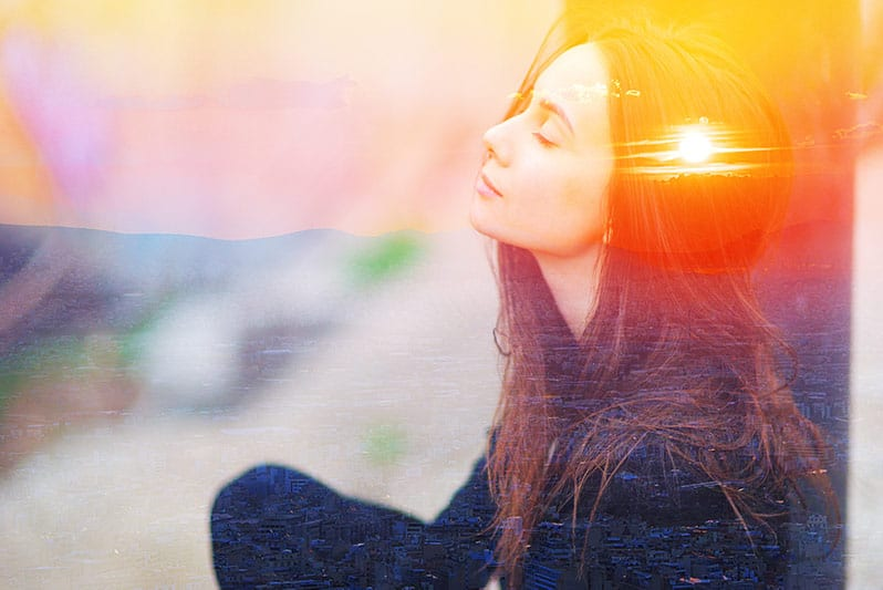 woman basking in the light. light therapy helps to overcome winter blues