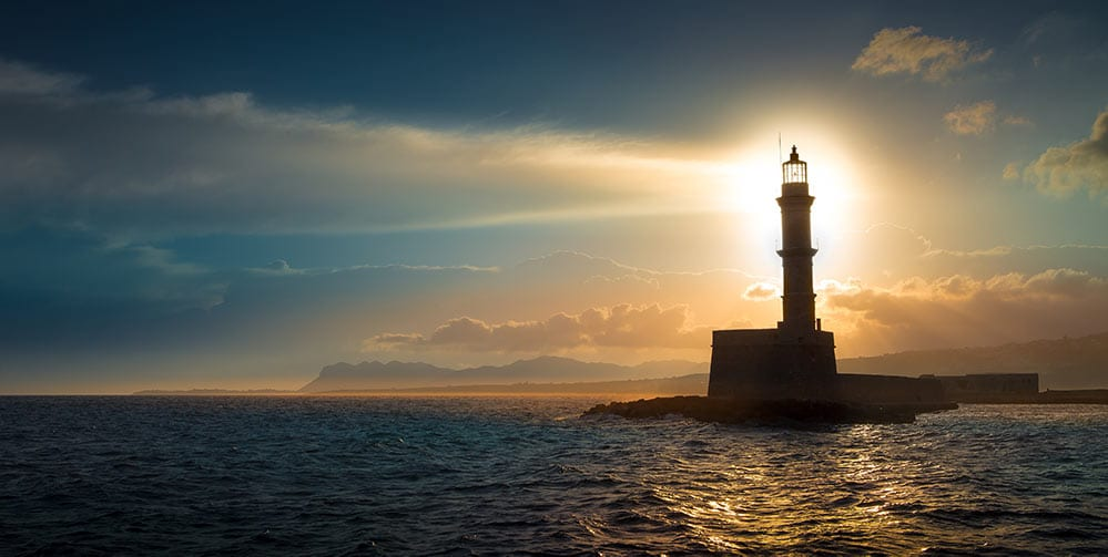 lighthouse with light shining at