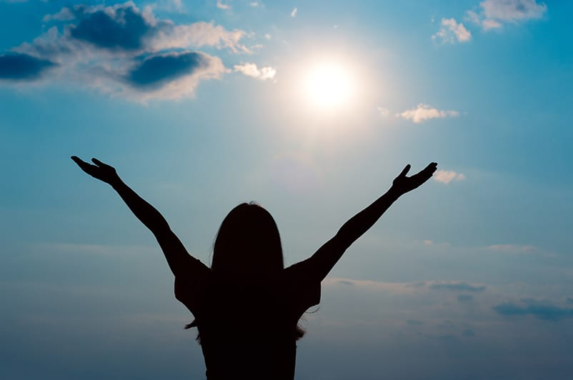 woman arms up surrendering