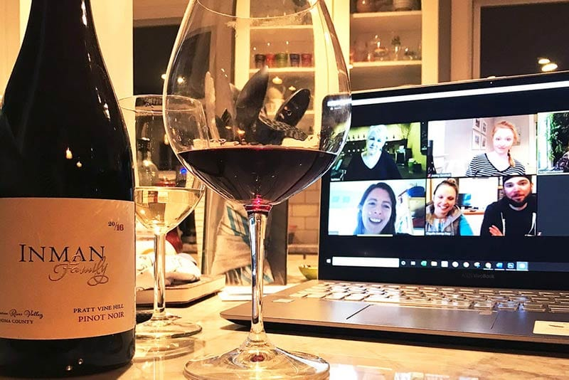 friends connecting doing a wine tasting on zoom