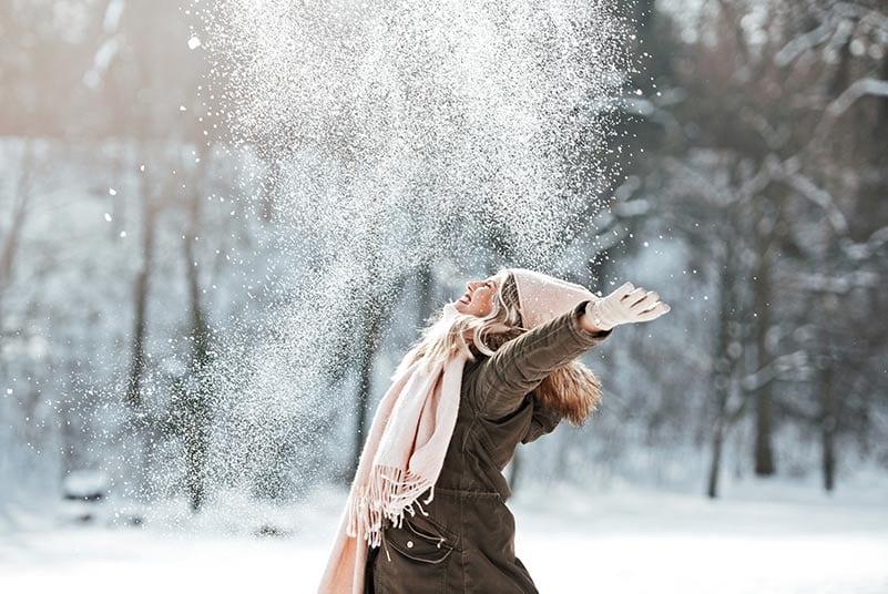 woman joyful in winter snow