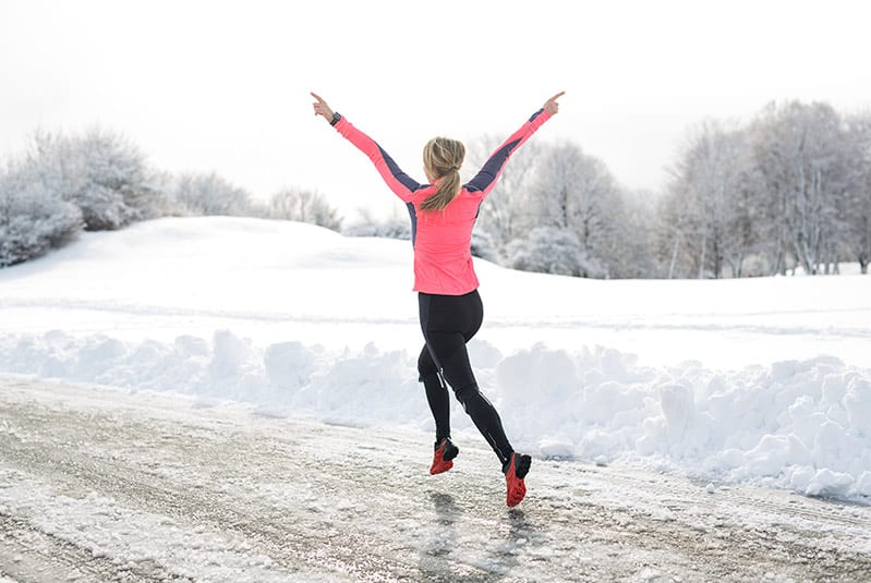 woman running outside in the winter