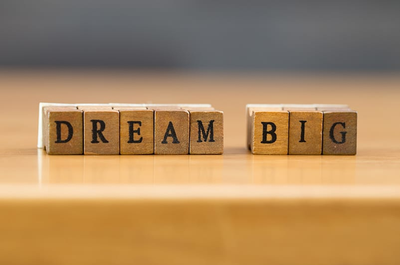 """Scrabble cubes spelling out the words """"dream big"""""""