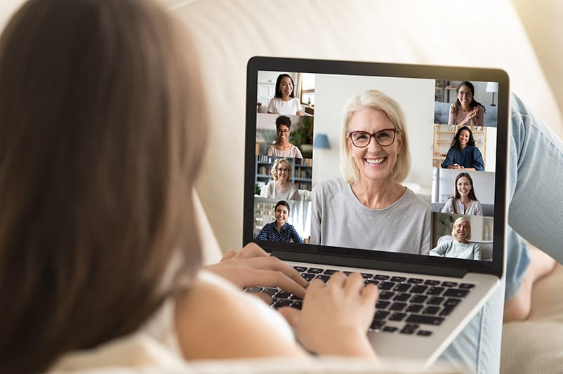 Woman connecting with friends on zoom