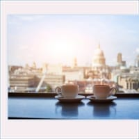 pink coffee cups with view of London