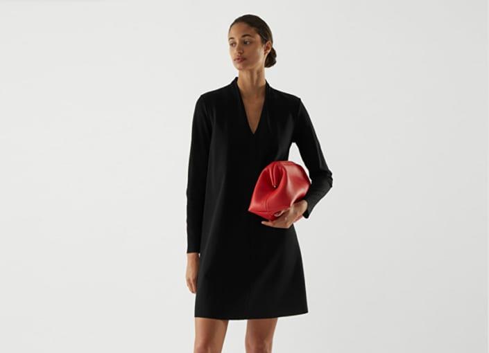 women in v-neck dress