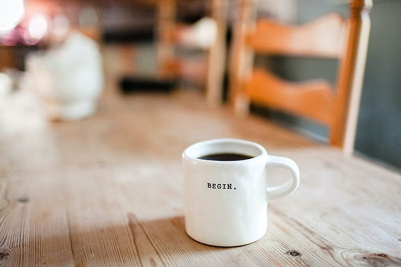 cup of coffee - with word begin written on it
