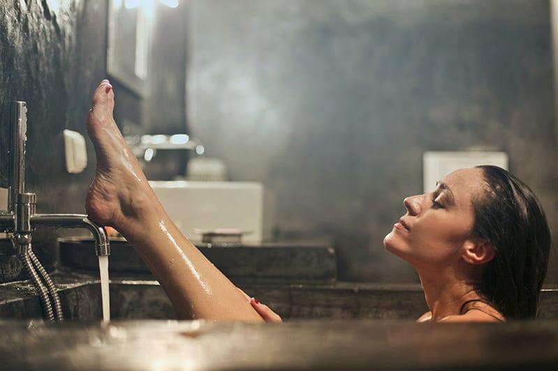 woman taking a bath- self-love