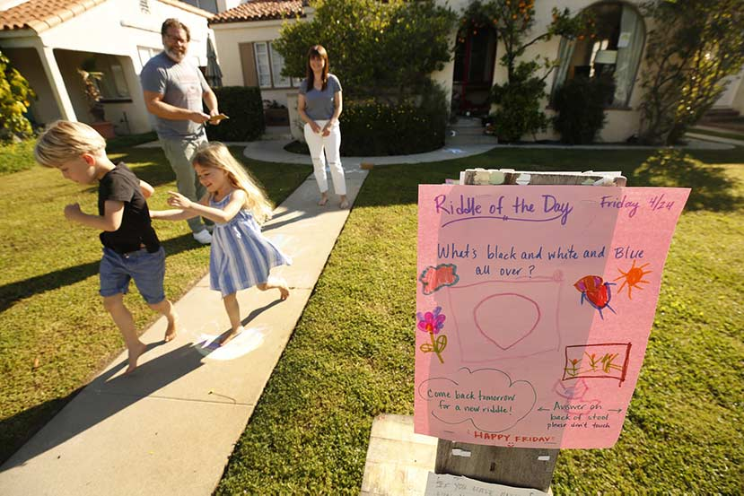 Family posts riddles in their yard to lighten the mood as an act of kindness during the pandemic