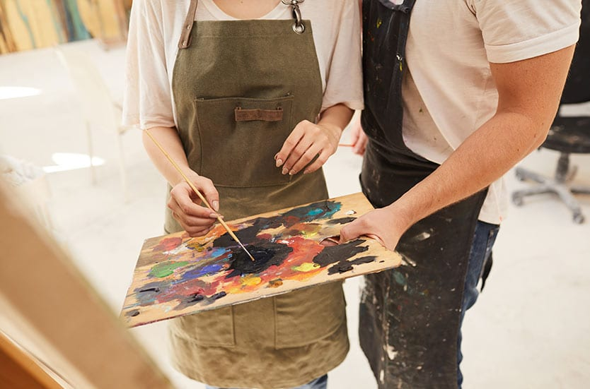 couple painting at home