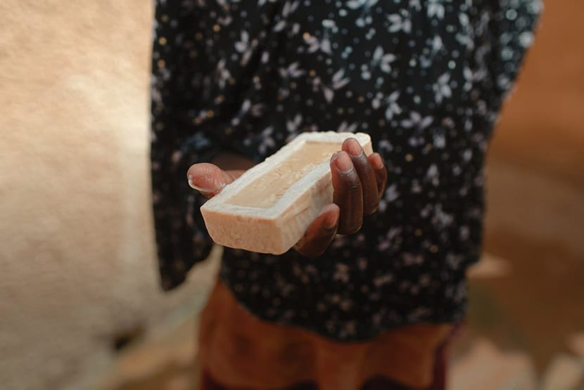 child holding bar of soap