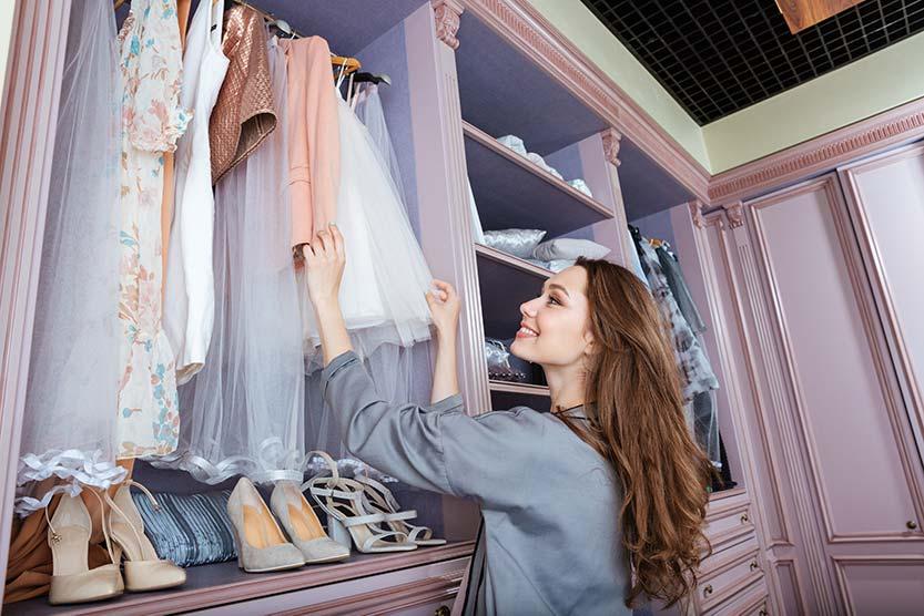 woman organizing closet