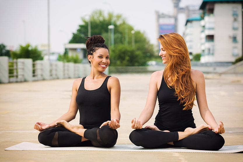 women friends meditating