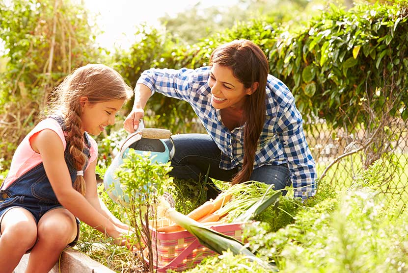 mother and daughter gardening - quality time