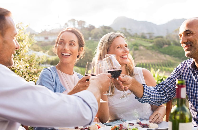 empty nesters - two couples having wine together