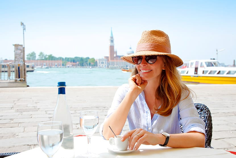 empty nester - woman sitting at an outdoor cafe