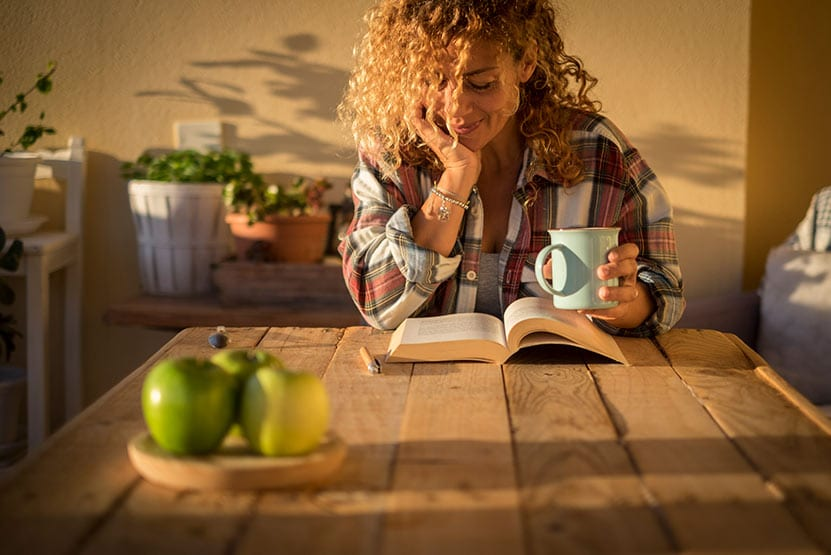 woman reading a book - early morning studying